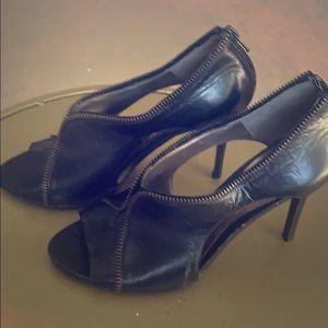 Black zippered Carlos Santana heels